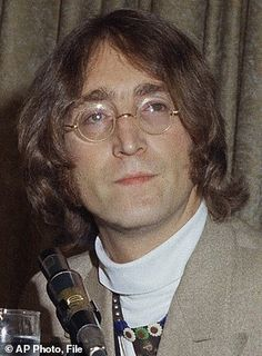 FILE - This 1971 file photo shows former Beatles singer and guitarist John Lennon at an unknown location. The draft of a two-page typed letter with handwritten annotations from John Lennon to Paul and Linda McCartney, thought to have been written in 1971 shortly after the Beatles' breakup, was sold by RR Auction, of Boston, Friday, Nov. 18, 2016, for nearly $30,000. (AP Photo, File)