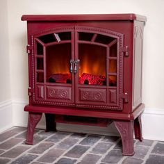 Free Standing Electric Stove Fireplaces - Duraflame 750 Cranberry Electric Fireplace Stove with Remote Control http://www.electricfireplacesdirect.com/products-accessories/free-standing-electric-stoves/duraflame-750-electric-fireplace-stove-cranberry-DFS-750-14