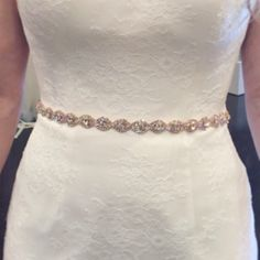 Add a little sparkle with this stunning rose gold bridal belt or bridesmaid belt! The crystals are in a rose gold setting and in a repeating double helix pattern. Paired with 60 of ribbon in color of your choice. Ties in bow in the back and beautifully drapes down the back of your dress.  Available in 4 sizes (select option in dropdown). To better understand how far the trim will extend on you/your bridesmaids, a size 4/6 is approx 27-29 in their waist:   - 12 Embellished Trim with 36 of…