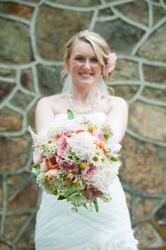 """brides bouquet: white hydrangea,pink david austin garden roses,david austin garden rose ivory """"patience"""",fever few(camomile),billy buttons,coral/peach ranunculus,white/blush peony,seeded euk,pink astibe,rice flower,daisy(was added because it was a tribute to her mom's bridal bouquet)"""