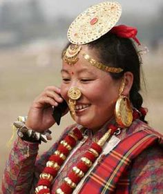 A woman of the indigenous Limbu ethnic group from Nepal's far east Taplejung district makes a call during a Taplejung cultural show in Kathmandu, Nepal, March 14, 2009 | © Xinhua Photo