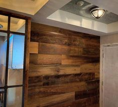 Here is a picture of a condo entranceway recently completed by a client.  They used our character, saw marked brown barn board to warm up the space.  In this case, they coated the boards with a clear polyurethane sealer - this deepens the natural colour of the wood. barnboardstore.com