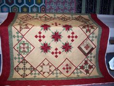 Memories of Christmas Past Quilt in cream, red and green.
