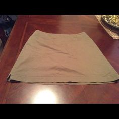 """Nike Fit Dri Golf SKORT Golf SKORT By Nike Fit Dri and super comfortable. Made of 51% Cotton 45% Polyester and 4% Spandex. The color is green. The size is 6. Laying flat from side to side is """"15. The Length is """"16.5. This item is in Good condition, Authentic and from a Smoke And Pet free home. All Offers through the offer button ONLY. I Will not negotiate Price in the comment section. Thank You Nike Skirts"""