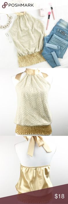 """Elegant Gold Halter Top Elegant golden top. Ties around neck area. Non see trough. Stretches.  Top to bottom: 23"""" Bust: 17"""" ( stretches to 20"""") Bottom part is also stretchy    ▪️NWT 🚫No Trades Tops"""