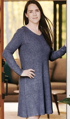 Slip into comfort with casually cool basics that are much more than basic. Smoky-blue pullover dress with criss-cross detail at back. A  women's fashion collection dedicated to boosting women's positive self-image with fashion designs created to flatter your shape so you can feel comfortable, confident, and totally yourself. #womensfashion #womensdresses #dresses #clothing #businessclothing
