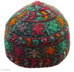 Hat. Turkmen baby's hat, mid-20th century. Silk embroidery on dark green silk; tan cotton lining; embroidered trim; circular machine-stitchi...