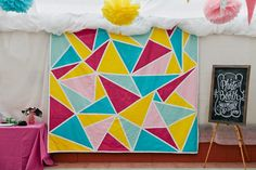 geometric photobooth backdrop and sign made by the bride - colourful new zealand wedding