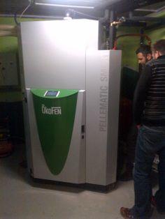Micro cogenerator Okofen burning pellet wood. 14 kW thermal load plus 1 kW power