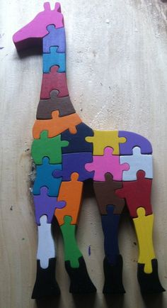 This handmade, hand-painted wooden Giraffe puzzle consists of 26 pieces. This puzzle is painted with non-toxic acrylic paints in a variety of colors. We have standard colors, neon colors, or pastel co Small Wood Projects, Puzzles For Kids, Wooden Blocks, Animal Crafts, Wood Toys, Laser, Giraffes, Toy Boxes, Neon Colors