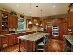 Huge #gourmet #kitchen with cherry cabinets and #granite features.