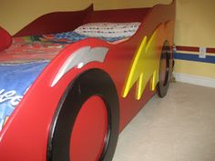 For his Lightning McQueen room, my son needed a race car bed. I wanted a bed that would fit a twin mattress, and the molded plastic car bed. Toddler Twin Bed, Twin Car Bed, Lightening Mcqueen Bedroom, Lightning Mcqueen Toddler Bed, Race Car Bedroom, Boat Bed, Kids Room Paint, Bed Lights, Disney Cars