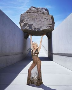 Michael Heizer's Levitated Mass at the Los Angeles Gwen Stefani photographed at the County Museum of Art wearing an Alexander McQueen gown and sandals with a Cartier bracelet