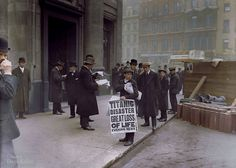 Newspaper boy Ned Parfett sells copies of the evening paper bearing news of Titanic's sinking the night before. (April 16, 1912)