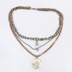 This necklace features a pin and a unique coin.  It is mixed alloy metal…