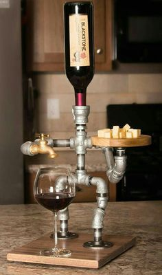 Wine or alcohol dispenser and cheese board. Got to get me one of these!