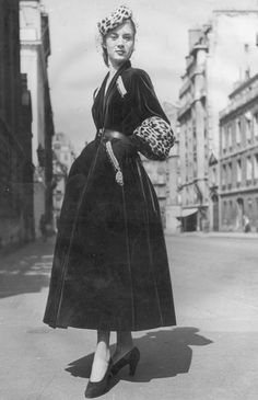 27 September 1947: 'Prince Igor', a Christian Dior design of full skirted green velvet coat with tight belt, gold and silver embroidery over slant pockets and deep leopard skin cuffs on three quarter length sleeves. A pillbox hat is also of leopard skin. Original Publication: Picture Post – Paris Forgets its 1947 – pub. 1947 (Photo by Savitry/Picture Post/Getty Images)