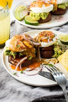 These Mexican-style Sweet Potato Eggs Benedict start with roasted sweet potatoes rounds that are topped with roasted tomato, chunky guacamole, and poached eggs then smothered in chipotle hollandaise. They're an insanely delicious breakfast recipe that just happens to be vegetarian   gluten-free  paleo   Whole30 approved. | theendlessmeal.com