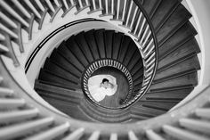 Great view of the bride at the bottom of a spiral staircase! Carolina Photosmith   Charleston Wedding Photography   The Lovely Find