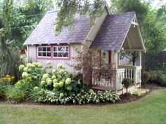 Beautiful garden shed with hydrangeas and other flowers