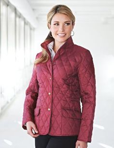 Tri-Mountain Womens 95% Polyester 5% Nylon Woven Poly-filled Quilted Sleeveless W/RJacket.