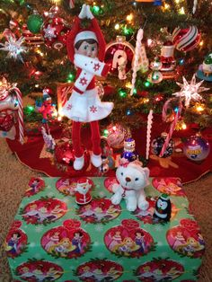 "Day 11, 2013 Afternoon - During nap time Sprinkle brought a ""broken"" (i.e. inappropriate) present to the North Pole and Santa found a new present for Sprinkle to bring to our daughter. Sprinkle also returned wearing her scarf and boots because it's snowing outside today - Elf on the Shelf Idea - Preschool Christmas Activity"