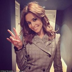 Peace out: Cheryl Fernandez-Versini flashed a peace sign as she posed backstage during day...