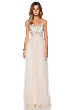 This floor-skimming Crystal Petal maxi dress from Needle and Thread features a beaded and rhinestone-embellished bodice, adjustable shoulder straps and a sweetheart neck. Cut to a flattering silhouette, this off-white maxi dress is an effortless way to make a style statement. Complement yours with sandals and gold-toned jewelry.