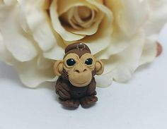 Check out this item in my Etsy shop https://www.etsy.com/listing/505022300/monkey-charm-animal-charm-polymer-clay