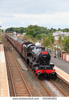APPLEBY, ENGLAND - AUGUST 15: Preserved steam locomotive 45690, Leander heads the Waverley into Appleby station on August 15, 2015, on the Settle to Carlisle railway.