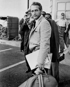 Paul Newman making a three button suit look good (somehow)
