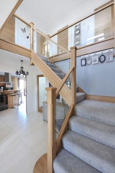 Modern mix of glass 038 natural oak with carpeted treads that sweep around the first-floor landing Allowing for a contemporary style staircase with. Staircase Frames, Painted Staircases, Modern Staircase, Staircase Design, Staircase Ideas, Railing Ideas, Staircase Bookshelf, White Staircase, Foyer Ideas