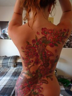 I'm not a huge color tat fan, but I do like this one.  With a backless black dress and hair to one side in a slick pony...yep.