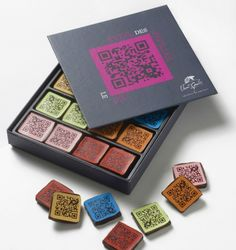 """Le Jeu chocolates, designed by French Chocolatier Vincent Guerlais, carries QR codes printed on them for a game called """"Awakening of the taste (Papillae) buds"""". One box contains 24 chocolates for Cool Packaging, Tea Packaging, Brand Packaging, Packaging Design, Product Packaging, Chocolate Brands, Chocolate Bark, Chocolate Truffles, Artisan Chocolatier"""