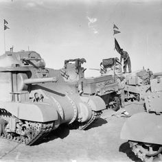 BRITISH ARMY NORTH AFRICA 1942 (E 9885) Newly-delivered Grant and Stuart tanks being spray painted shortly after their arrival in the Middle East, 29 March 1942.