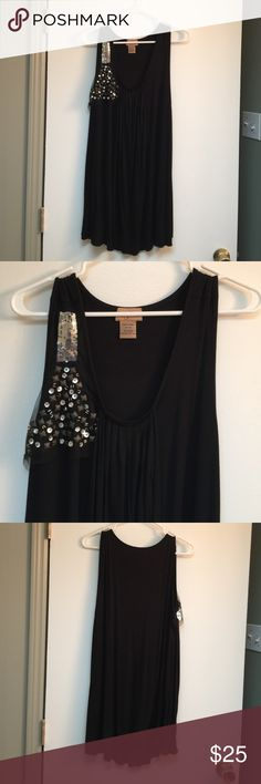 NWOT black tank top with bling Black tank top has a nice drape and some bling on the the right side. 95% rayon 5% spandex Midnight Velvet Tops Tank Tops