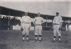 """Cardinals players at opening day, 1912    Three Cardinals players at opening day, 1912. Left, Joe Willis, right William """"Wheezer"""" Dell. Photograph by William H. Trefts, Jr, 1912. Missouri History Museum Photographs and Prints Collections. William Trefts Collection. n29617."""