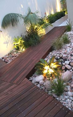 When designing your backyard, don't forget to carefully plan your lighting as well. Get great ideas for your backyard oasis here with our landscape lighting design ideas. Small Backyard Landscaping, Tropical Landscaping, Backyard Fences, Modern Landscaping, Backyard Ideas, Landscaping Ideas, Garden Ideas, Balcony Ideas, Gazebo Ideas