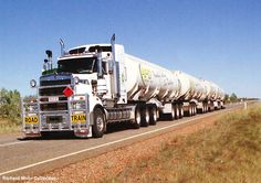 A Kenworth Tractor Truck Driver towing 4 Fuel Tanker Trailers for an Australian Fuel Distributor, Photo taken passing through Wycliffe Wells, in outback Australia. Big Rig Trucks, Toy Trucks, Semi Trucks, Train Truck, Road Train, Kenworth Trucks, Chevrolet Trucks, Peterbilt, Big Girl Toys