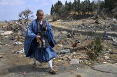 A monk praying in the aftermath of the March 11 earthquake/Japan