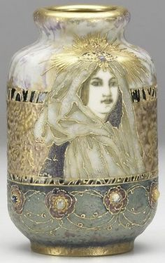 Type:  teplitz   Origin:  Austria   Year:  1880 - 1920     A Riessner, Stellmacher & Kessell, Amphora porcelain vase in Gres-Bijou with crowned lady. Stamped AMPHORA with crown,