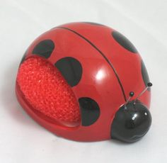 """Ladybug Scrubby Holder  The Ladybug Scrubby Holder is the perfect accessory for your kitchen or bathroom!  Tucked inside is an non abrasive scrubby which can be used to clean the dishes, and when you are finished you can hide it away inside the holder.  The ladybug is made from ceramic and measures approximately 4"""" long."""