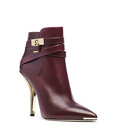 Shine bright with the season's glamorous metallic-accented shoes. An ultra-chic silhouette with a point toe and wrap-around strap, our Averie ankle boots make a refined statement with our signature lock charm and high-shine hardware. Pair them with anything from jeans to a dress to elevate your ensemble.