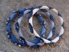 I am not the original pinner of these beautiful bracelets. I'm not sure where to find a pattern or tutorial.
