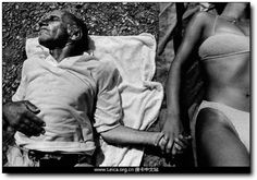 Alex Majoli / Magnum Photos // GREECE. Dodecanese Islands. Leros beach. A [psychiatric] patient and a care worker lie in the sun. 1994.