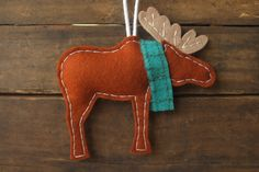 Moose Holiday Ornament - Cute Woodland Animal with Turquoise Scarf - Wool Felt Ornament. $19.20, via Etsy.
