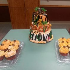 Safari baby shower cake and cupcakes