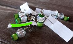 Lantern swap - Beads, sequins, and a headpin (from the jewelry making section of your craft store). The green 'base' is a pony bead, and the 'light; is just a big clear bead. String them onto the headpin and bend the top to keep them on.