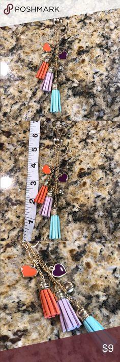 Key chain. NWOT. Orange purple blue tassels Key chain. NWOT. Orange purple blue tassels. Love it!💕 light weight so ur purse doesn't get any heavier! 😊 Accessories Key & Card Holders