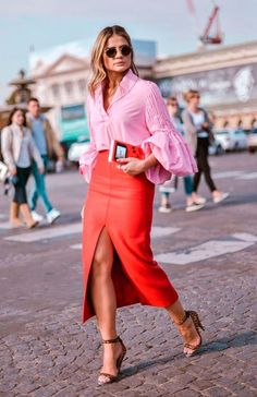 Long red skirt with front slit and pink top with ruffle bell sleeve